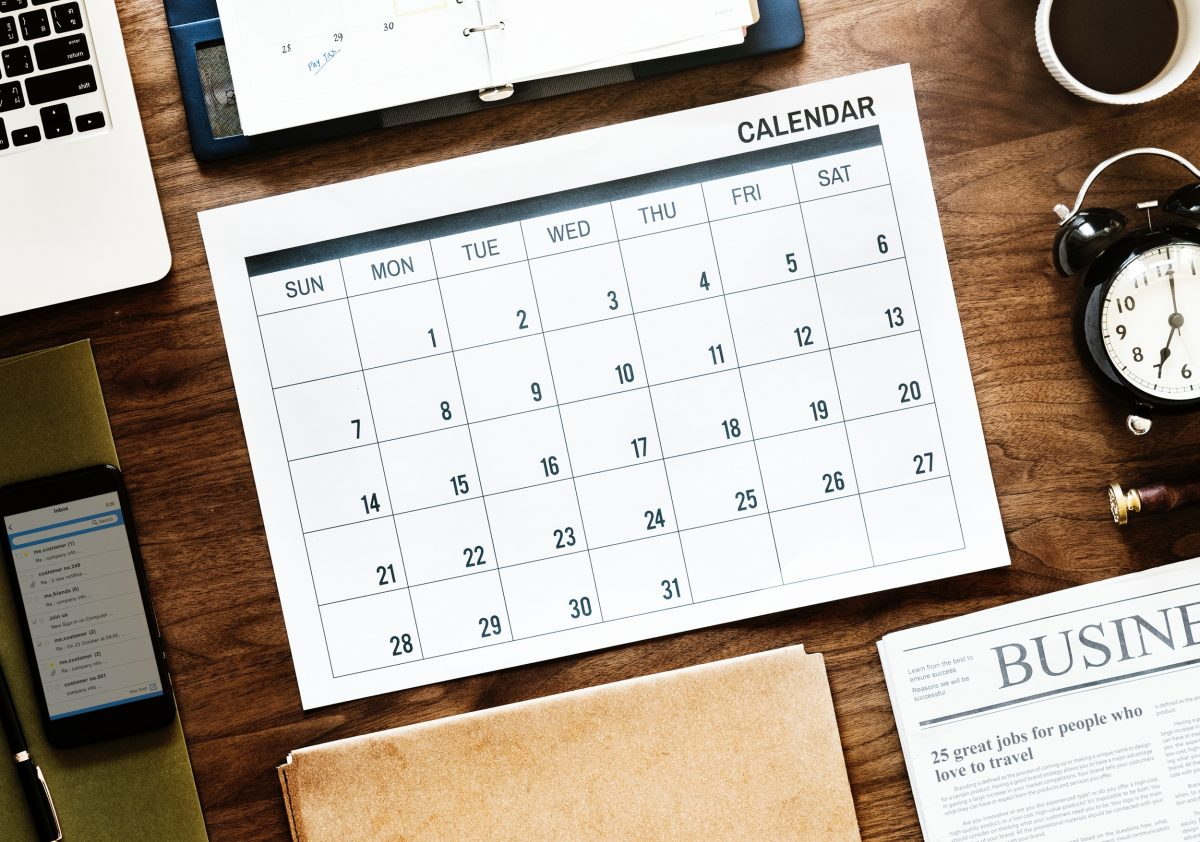 Black and white monthly business calendar on a desk